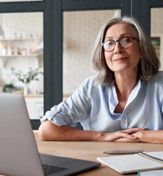 elderly lady in front of laptop